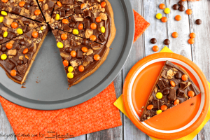 Peanut butter cookies just got even better! A giant peanut butter cookie is covered with a delicious chocolate, peanut butter topping and loaded with all your favorite candies!