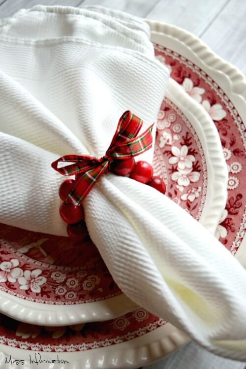 These Cranberry Wreath DIY Napkin Rings are so cute and easy to make to dress up your holiday table