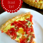 A quiche/tart with fresh tomatoes, basil and swiss cheese