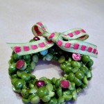 Make these cute wreath pins from glue and split peas. I made about 20 for under $10 perfect for teachers and friends! Great Christmas Craft