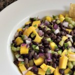 The Perfect Summer Salad, black bean mango salad works as a side, an appetizer or a dip. It