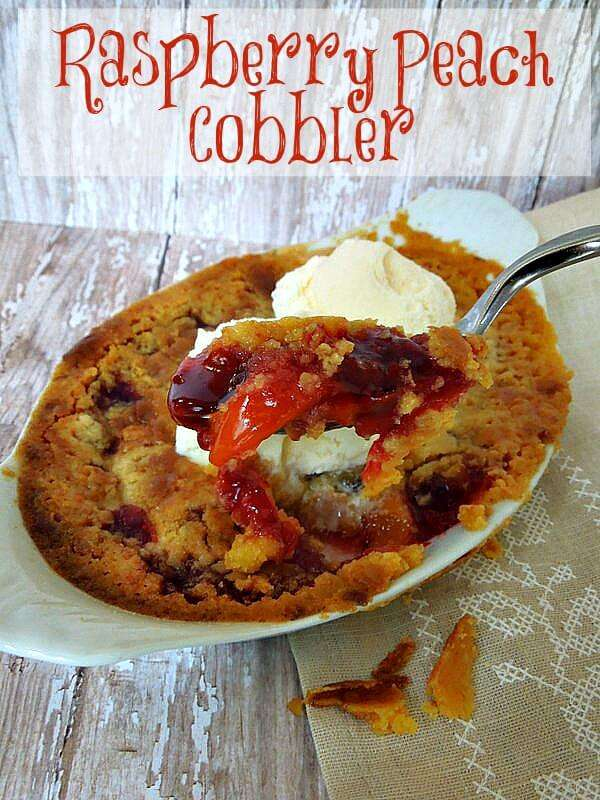 Easy Peach cobbler with Raspberry with a buttery crust and rich fruit filling. It's a dump cobbler and only takes 4 ingredients to make the perfect cobbler