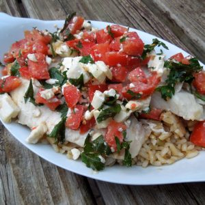 Greek Roasted Tilapia is full of flavor with garlic, feta and tomatoes and is a quick weeknight meal it's our favorite fish dish