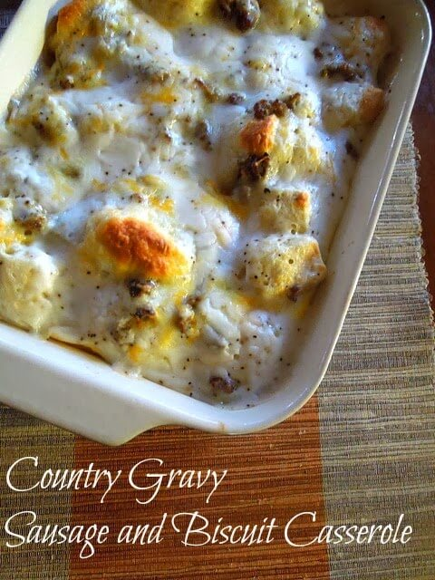Biscuits and Gravy Casserole in a dish on a orange and tan table runner
