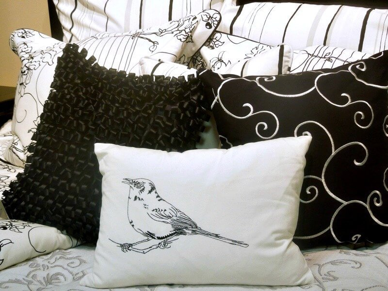 I love this bird pillow, great bed ensemble #havertysrefresh
