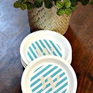 Making Coasters is easy with terra-cotta plant saucers. It's a great Cricut Project or just use scrapbook stickers