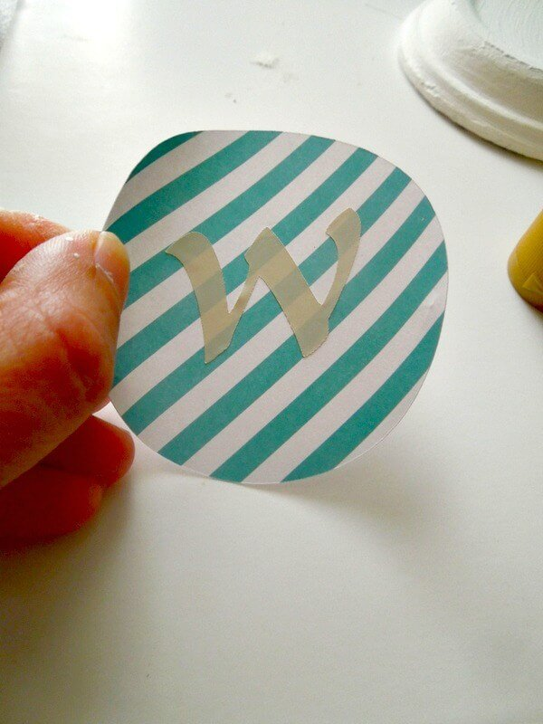 Make Easy monogrammed coasters with terra cotta plant saucers, mod podge and some scrapbooking supplies
