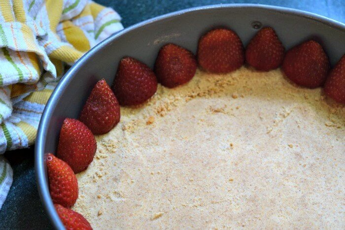 Line strawberries along the edge of a spring form pan to make a great design on the outside of a pie