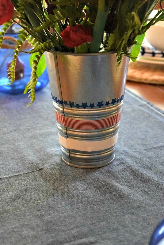 Pep up a plain old vase with washi tape to liven up a holiday or party table