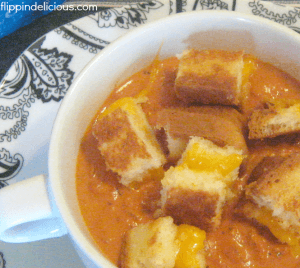 creamy-tomato-soup-with-grilled-cheese-croutons-close-up-300x268
