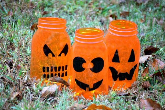 This has lots of great Mason Jar Halloween Ideas like these painted luminaries
