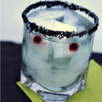 Make these fun Frankenstein Halloween Cocktails with Gummy eyeballs and black sanding sugar!