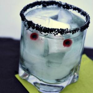 Make these fun Frankenstein Halloween Cocktails with Gummy eyeballs and black sanding sugar!