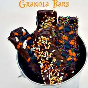 These easy to make chocolate covered granola bars are a perfect healthy halloween treat and fun to take to school!