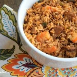 An easy shrimp jambalaya recipe from my friend who grew up in New Orleans so you know it's gotta be good! Keep warm in a crockpot for parties!