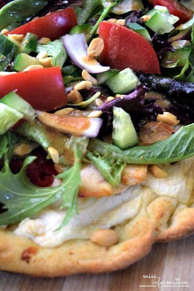 Thai Salad Pizza will cause you to crave more. A crispy crust with a creamy honey roasted garlic riccota cheese, roasted chicken, salad and a quick peanut dressing drizzled on the top