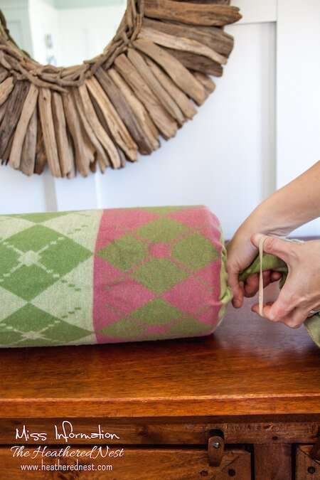 DIY a bolster and a 1 minute changeable cover with things already in your home, making it FREE! Pin it to make it!