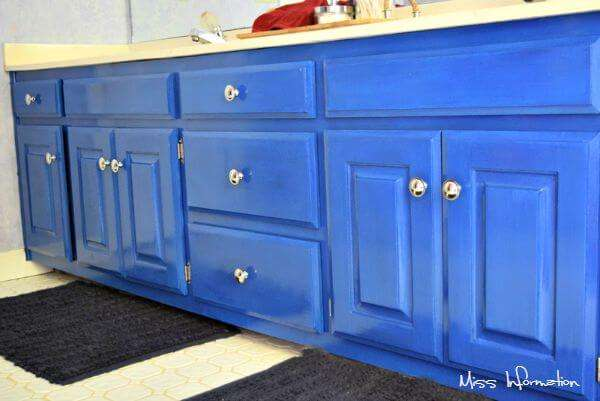 Before and After of a nautical children's bathroom just by painting existing cabinets and accessorizing