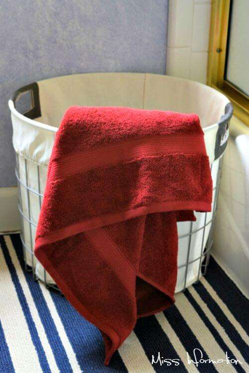 This cute wire basket from Target makes a perfect clothes hamper in the bathroom and this outdoor rug runner works great as a bathmat