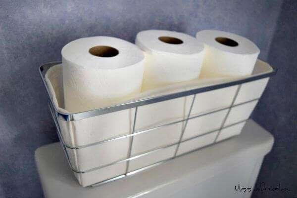 Use a tank basket to hold extra toilet paper no more hunting needed