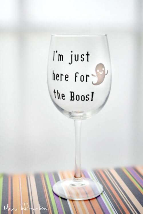 Love this I'm just here for the boos wine glass. They are perfect to trick or treat with! Made with a Cricut and Vinyl. Gotta Pin these for my friends!
