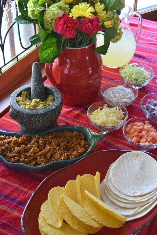 The Ultimate Taco Bar perfect for Game Day! This taco recipe is the bomb!