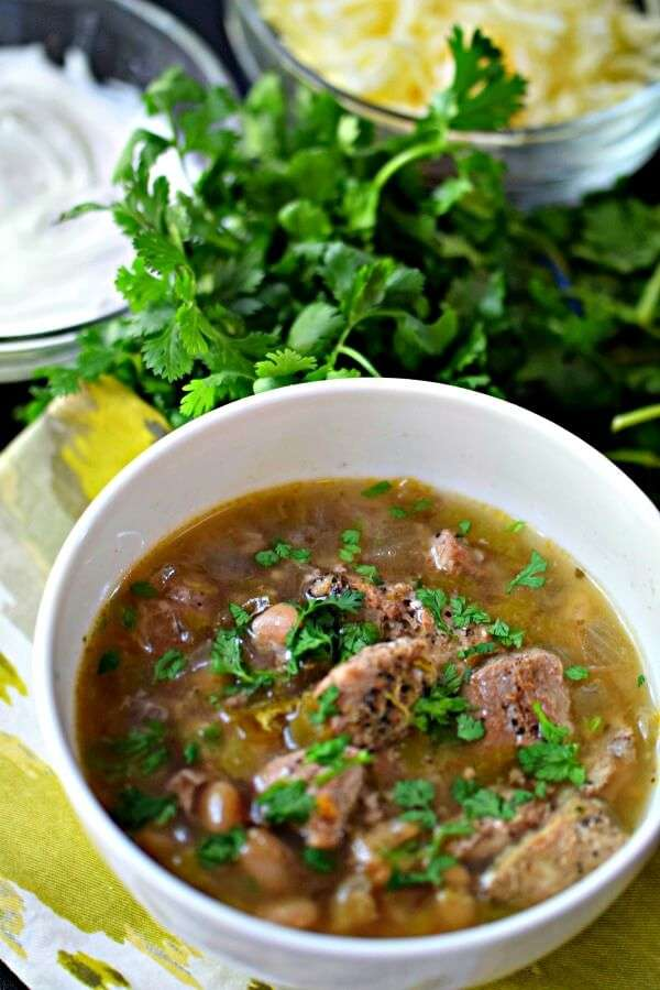 Make an easy dinner that will wow your family so much they'll think you slaved over it! This white chili crock pot recipe is made with marinated pork loin instead of chicken and takes about 10-15 minutes to get in the slow cooker! My kids loved it.