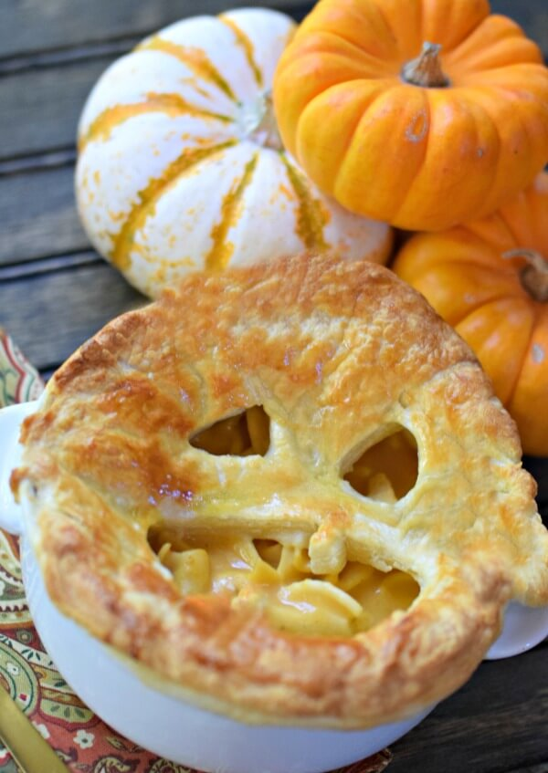 Make dinner fun for the holidays with this 10 minute easy creamy pumpkin and chicken noodle soup recipe by adding a puff pastry topper for soup carved like a pumpkin!