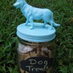 Make a cute pet treat jar by gluing on a plastic toy and spray painting the lid