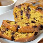 This easy pumpkin bread recipe is loaded with chocolate chips and topped with a caramel glaze to make this the decadent and best pumpkin bread recipe