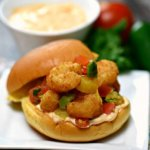Easy Popcorn Shrimp Sliders with a grilled mango salsa and sriracha mayonnaise are a quick summertime meal and our kids love them!